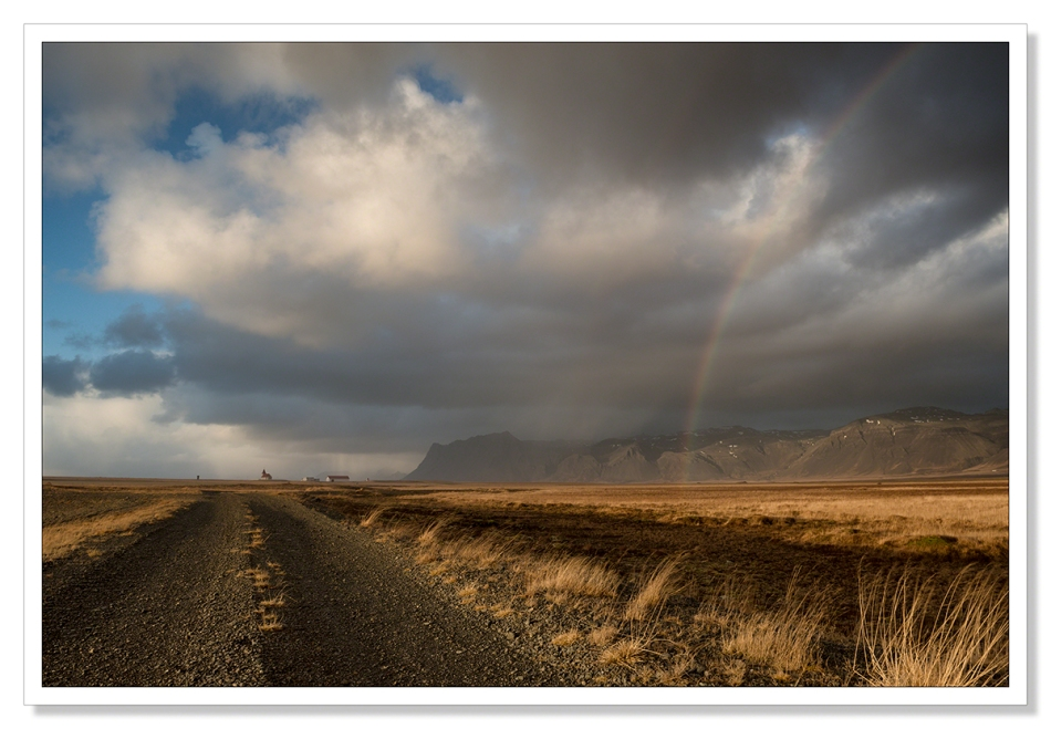 Landscape photograph, Fáskrúðarbakkakirkja, church with rainbow, clouds, Iceland, waiting for the light