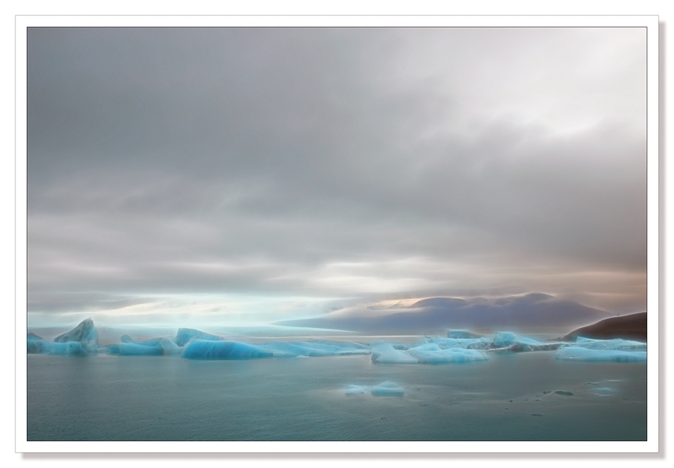 Jökulsárlón, Jokulsarlon, landscape photograph, Icebergs floating in the lagoon beneath the glacier edited with Topaz Glow