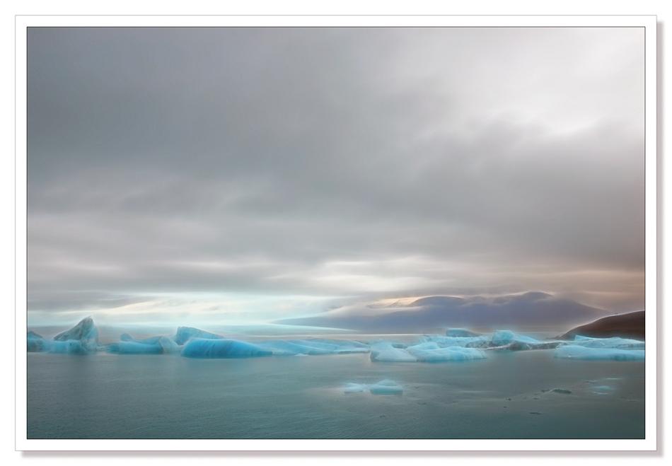 Jökulsárlón, Jokulsarlon, landscape photograph, Icebergs floating in the lagoon beneath the glacier edited with Topaz Glow