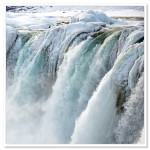 A close up of Godafoss waterfall frozen in the depths of winter..